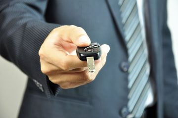 16849783 - businessman handing a car key